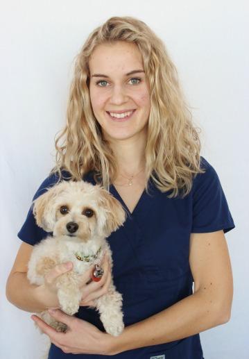 Staff member Lisa DeBoer with pet dog at Stretsville Animal Hospital